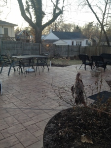 Today, a stamped concrete patio provides plenty of room for entertaining, relaxing and enjoying the garden