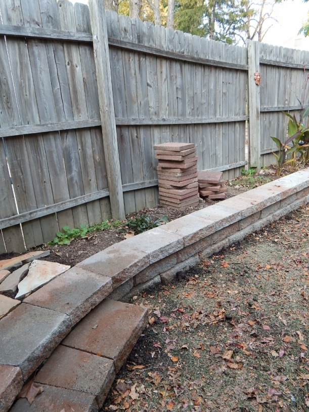 The lower left is the step added to the wall at the entrance to the yard. I do like the curve.
